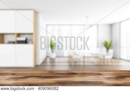 Wooden Desk On Blurred Background Of White And Wooden Room With Chairs On Parquet Floor. Waiting Roo