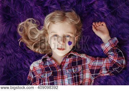 International World Epilepsy Illness Awareness Day. Cute Pretty Blonde Caucasian Girl With Small Vio