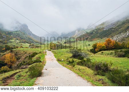 Road In A Valley In Somiedo National Park In Asturias, Spain On A Rainy Autumn Day. Scenic Autumnal