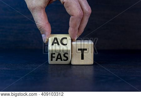 Time To Act Fast Symbol. Businessman Turns A Wooden Cube With Words 'act Fast'. Beautiful Grey Backg