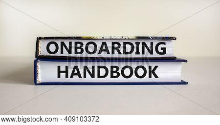 Onboarding Handbook Symbol. Books With Words 'onboarding Handbook' On Beautiful White Background. Bu