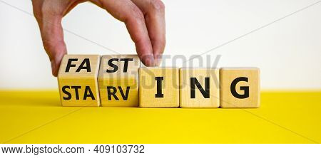 Fasting Or Starving Symbol. Doctor Turns Wooden Cubes And Changes The Word 'starving' To 'fasting'.