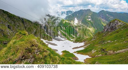 Summer Landscape Of Romanian Carpathian Mountains. Wonderful Nature Scenery With Clouds On The Peaks
