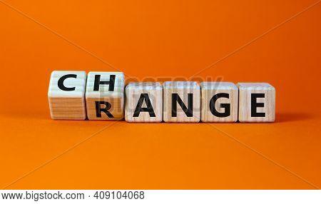 Change Range Symbol. Turned Cubes And Changed The Word 'change' To 'range'. Beautiful Orange Backgro