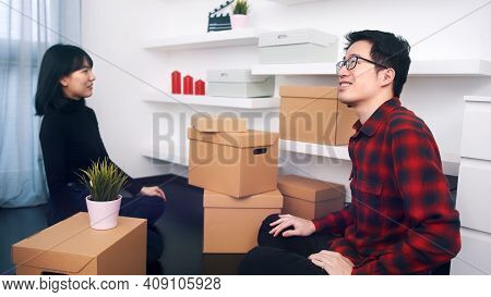 Happy Newlywed Asian Couple Relocating To New Appartment. High Quality Photo