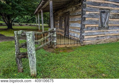 Abandoned Old Pioneer Log Cabin Closeup View Of The Front Entry With Porch Locked And Boarded Up Sur