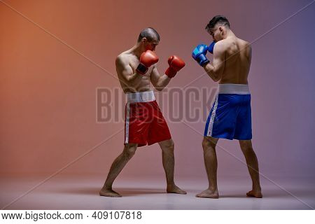 Wrestling Of Two Fighting Males Boxers Standing In Stance In Red Light In Studio, Martial Arts, Mixe