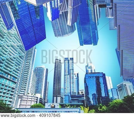 Downtown Miami Cityscape View With Condos And Office Buildings Against Blue Sky. Collage