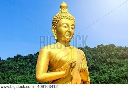 Magha Asanha Visakha Puja Day. Golden Buddha On Natural Background.