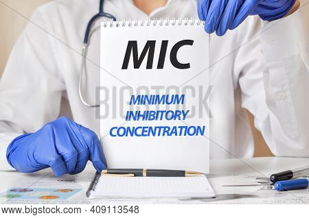 Doctor Holding A Tablet With Text: Mic, Medical Concept