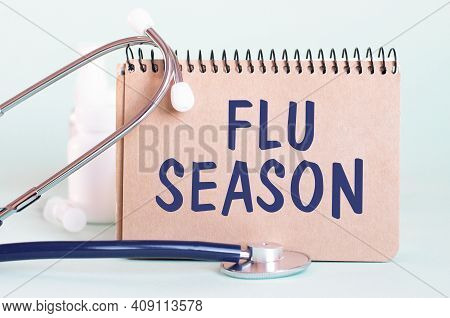 Flu Season Text Written On A Paper Notebook, Medical Concept