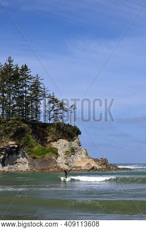 Paddle Boarder In Sunset Bay State Park, Oregon