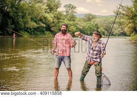 Dynamic Hobbies. Two Happy Fisherman With Fishing Rod And Net. Camping On The Shore Of Lake. Hunting