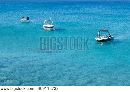 Travel Entertainment Boats Resting On The Calm Sea With Turquoise Water In The Mediterranean. Protar