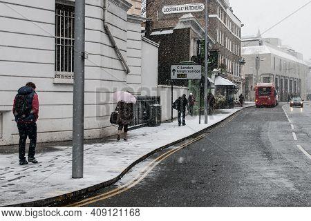 London, England, January 18 2013: People Walking In The Streets Of Frozen London Heavy Snowstorm Sno