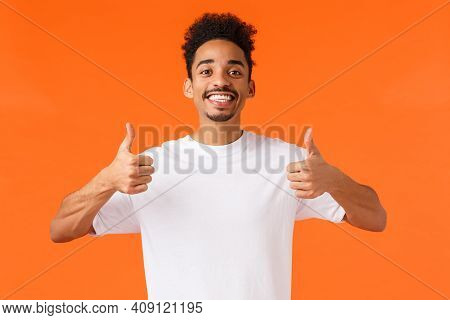 Optimistic, Enthusiastic African-american Male In White T-shirt, Fully Agree, Feeling Happy And Sati