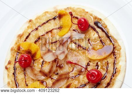 sweet pizza with peach and cherries