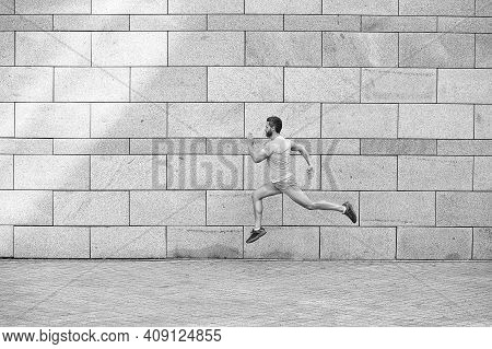 Man Running Outdoor. Healthy Male Runner. Hurry Up. Full Length Portrait Of Fitness Guy Running. Ach