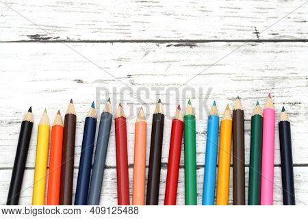 Wooden Colorful Pencils On White Wooden Table