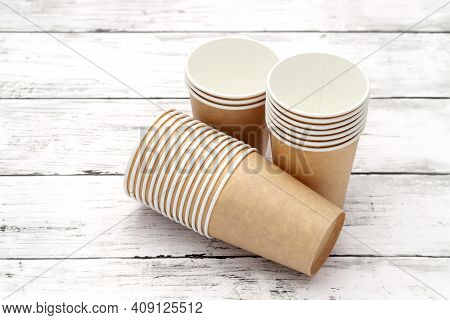 Empty Disposable Paper Cup On White Wooden Table