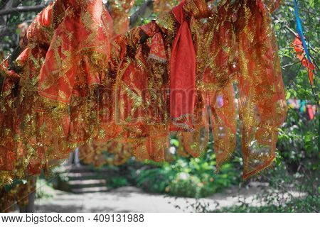 Red Cloth Wrapped Around Blessing Tree In Hinduism Temple