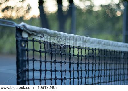 Close Up View Of Tennis Net On Empty Tennis Court In Stanley Park Due To Covid-19 Restrictions