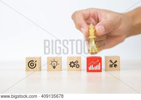 Hand Choose King Chess On Wooden Toy Blocks Stacked With Graph Icon Concepts Of Business Team Strate