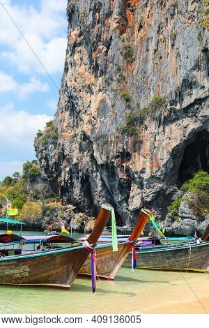 One Of Thailand's Prettiest Beaches Phra Nang  Located Adjacent To Railay On Krabi. Long Tail Boats