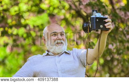 Cool Selfie. Professional Photographer Designer. Man Tourist Use Camera Take Photo Of Cherry Blossom