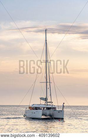 Komiza, Croatia - Aug 17, 2020: Man Fishing On Catamaran In Adriatic Sea Vis Island In Summer