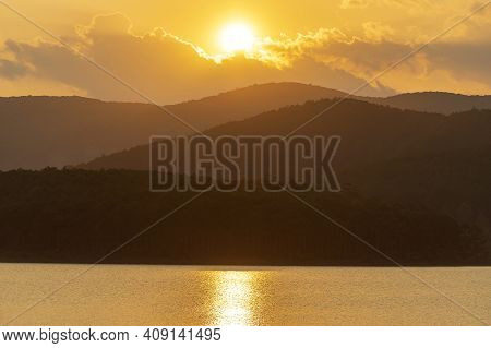 Beautiful Sunset Over The Lake And Mountains Near Dalat, Vietnam. Travel And Nature Concept
