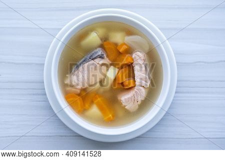 Fresh Salmon Fish Soup With Carrots, Potatoes And Onions In A White Plate, Close Up. Tasty Dinner Co