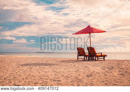 Beautiful Sunset Beach Scene. Chairs On The Sandy Beach Near The Sea. Summer Holiday And Vacation Co