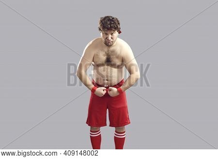Funny Topless Young Man With Some Belly Fat Flexing Arms Pretending To Be Tough Guy