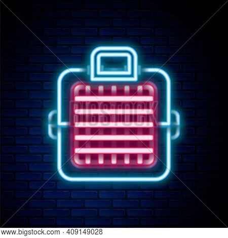 Glowing Neon Line Pet Carry Case Icon Isolated On Brick Wall Background. Carrier For Animals, Dog An