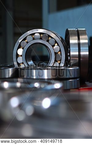 Finished Products Bearings In Production. The Glossy Surface Of Steel Products. Industrial Industry
