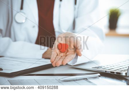 Unknown Woman-doctor Holding Little Heart In Her Hands. Childrens Cardiology And Medical Care, Stop