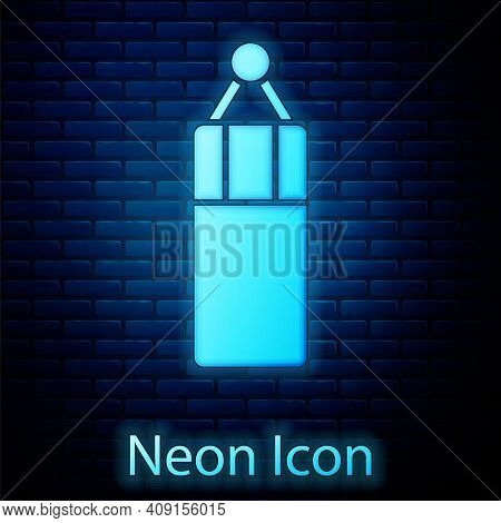 Glowing Neon Punching Bag Icon Isolated On Brick Wall Background. Vector