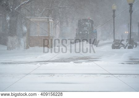 Snow Removal Equipment, Utilities And Municipal Services Are Clearing The Snow From The Streets In T