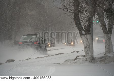 Snow-covered Road With Cars In A Storm,blizzard Or Snowfall In Winter In Bad Weather In The City.ext