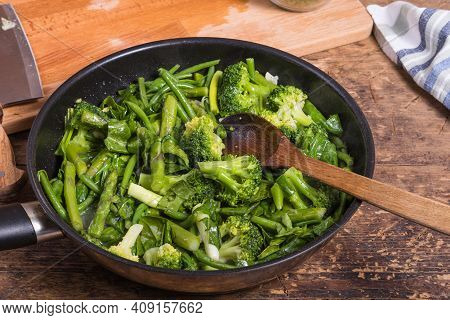 Cooking Green Vegetables For Pasta In A Frying Pan - Beans, Broccoli, Asparagus In A Frying Pan On A