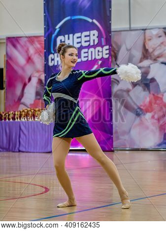 Moscow, Russia - December 22, 2019: Sports Dance Teenager Girl With Pompons At Cheer Challenge Cheer