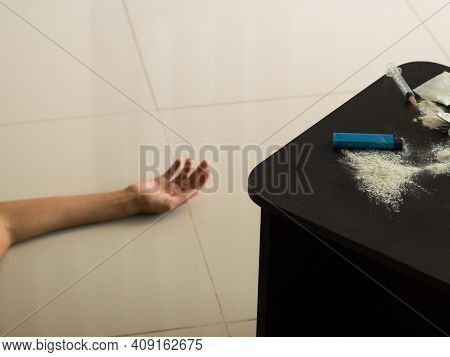 Heroin, Injection,injection Needle On Dark Wooden With Hand Asian Women  Blur Image. Heroin Is Hard