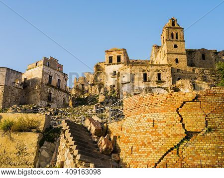 Dramatic View Of Craco Ruins, Ghost Town Abandoned After A Landslide, Basilicata Region, Southern It