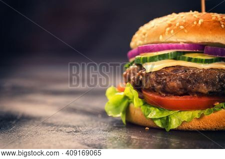 Fast Food Burger. Delicious Burger With Sauce, Cheese, Bacon And Vegetables. Mouth-watering Sandwich