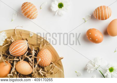 Modern Easter Eggs And Spring Flowers On White Background. Flat Lay, Top View, Copy Space. Happy Eas