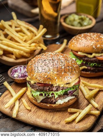 Elicious Burger With Sauce. Hamburger. Delicious Grilled Angus Burger With Cheese, Salad And Tomatoe