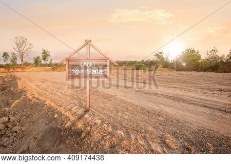 Land Sales Sign, Land Plot For Housing Construction Project With Car Tire Print In Rural Area And Re