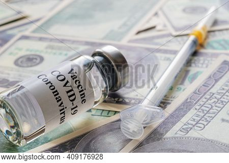 Ampoule With Vaccine And Injectable Insulin Syringe Lying Down On Dollar Bills, Vaccination And Trea