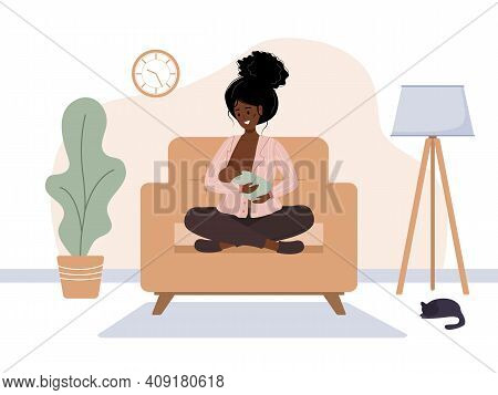 Breastfeeding Concept. Young African Mother Sitting On Armchair And Nursing Newborn Baby. Natural Fe